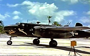 Photo of a 75mm equipped  North American B-25G Michell medium bomber from the 48th Bomb Squadron, 7th Army Air Force, on the runway on the Island of Apamama in the Gilbert Islands in World War 2