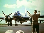 World War 2 color photo of Boeing B-29 Superfortress taxiing in after a mission.